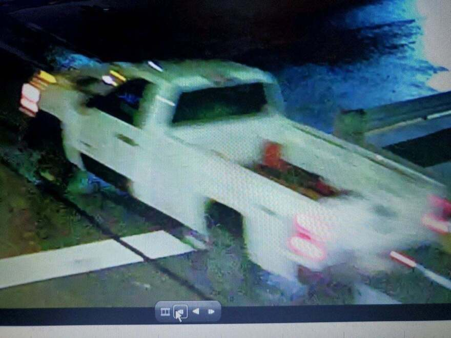 Police are looking for a white truck in connection with an indendiary device thrown from a moving vehicle, which damaged a parked car in Pittsburgh's Lawrenceville neighborhood on Sunday night.
