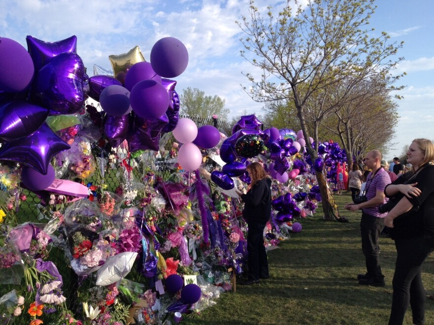 Scores of fans visited Prince's Paisley Park compound in Chanhassen, Minn., on Saturday afternoon. The fence has rapidly become a makeshift memorial celebrating the life of the artist.