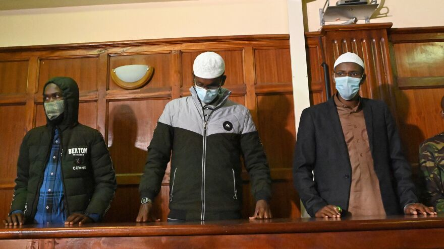 Suspects (left to right) Hassan Hussein Mustafa, Liban Abdullahi Omar, and Mohamed Ahmed Abdi standing in the dock during their appearance for their case at the Milimani court in Nairobi on Wednesday. Abdi and Mustafa were found guilty, while Omar was acquitted of charges.
