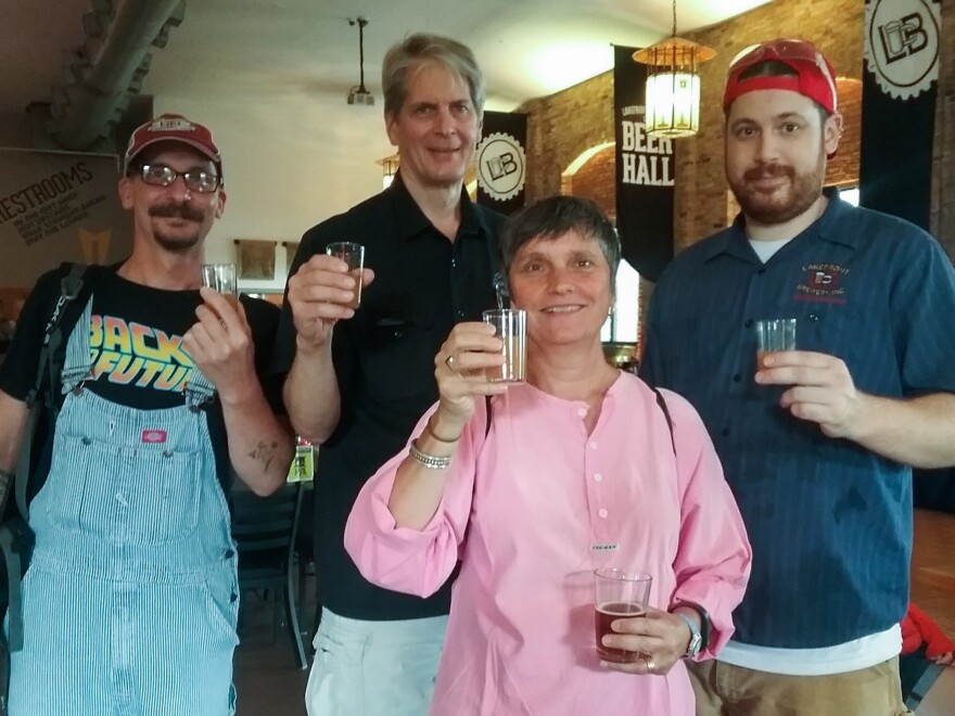 Archaeologist Bettina Arnold (center) and her team uncovered the cauldron containing remnants of the ancient alcoholic beverage. She teamed up with Lakefront Brewery in Milwaukee to re-create the recipe. Mike Vergolina (from left), Russ Klisch, Arnold and Chad Sheridan toast with the finished product, a braggot based on a 2,500-year-old recipe.