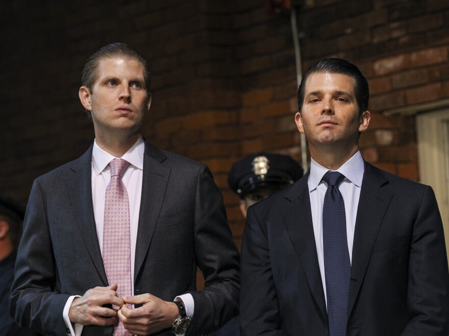 President Trump's sons Eric (left) and Donald Jr., pictured at a 2015 campaign event, are overseeing resorts still underway in places such as the Philippines and Indonesia.