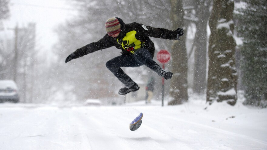 A large and powerful winter storm brought snow and ice to large sections of the Midwest and East Coast Wednesday. The weather made roads treacherous in many areas. But in Pittsburgh, Pa., Chandler Fescemeyer, 17, found a reason to break out a snowboard.