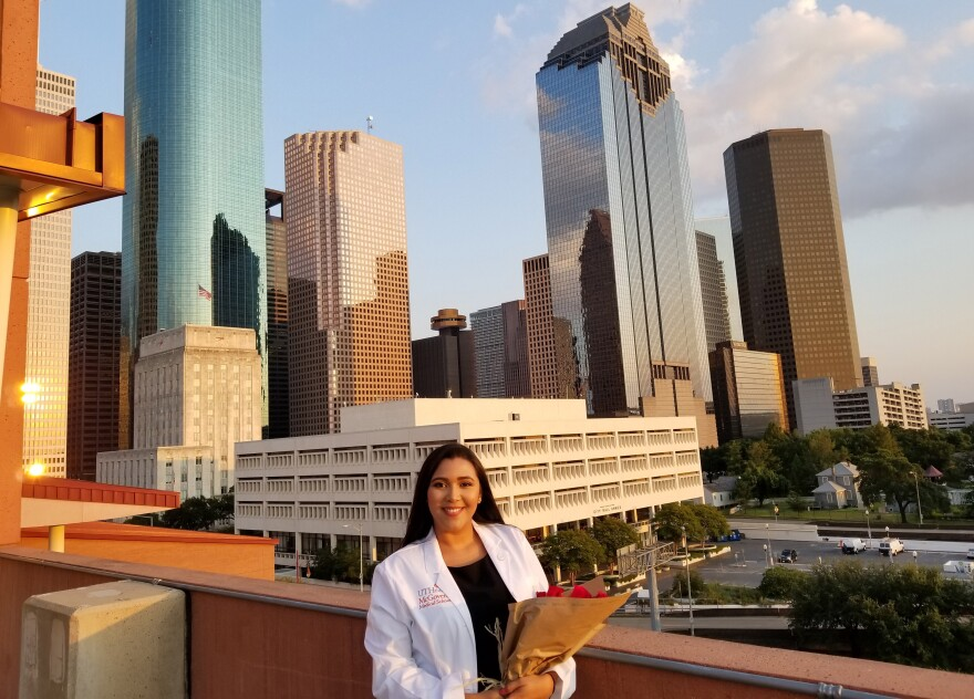 """Andrea Hernandez poses during a """"white coat"""" ceremony in August to welcome her to the medical profession at UT Health in Houston."""