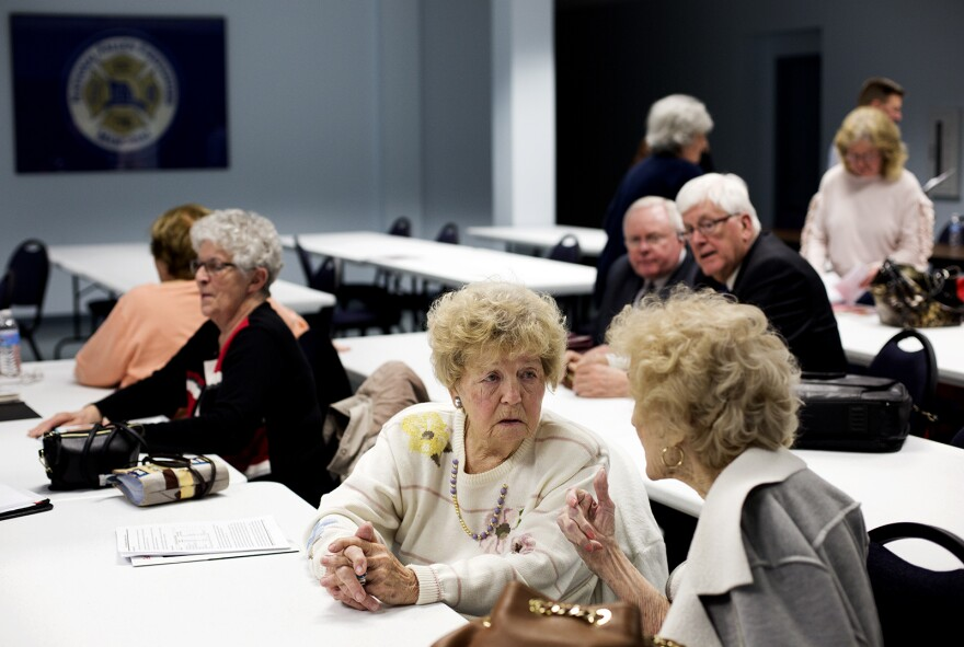 Mackenzie village board members, including Pat Arrendell and Dorothy Berry, sat up front for a community meeting on March 21 about what would happen if their village disincorporates.