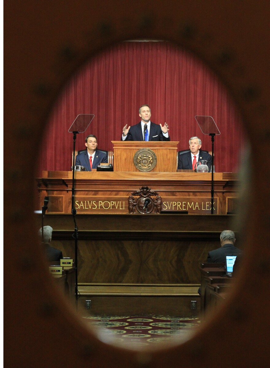 Missoouri Gov. Eric Greitens is seen through the chamber doors, delivering his first State of the State speech to the Missouri Legislature. (Jan. 17. 2017)