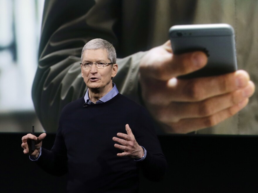 Apple CEO Tim Cook introduces the latest version of the iPhone on Monday in Cupertino, Calif. The company's legal fight with the FBI may be at an end, or at least a detente, if a third party's suggestion lets the agency hack into the San Bernardino shooters' encrypted iPhone.
