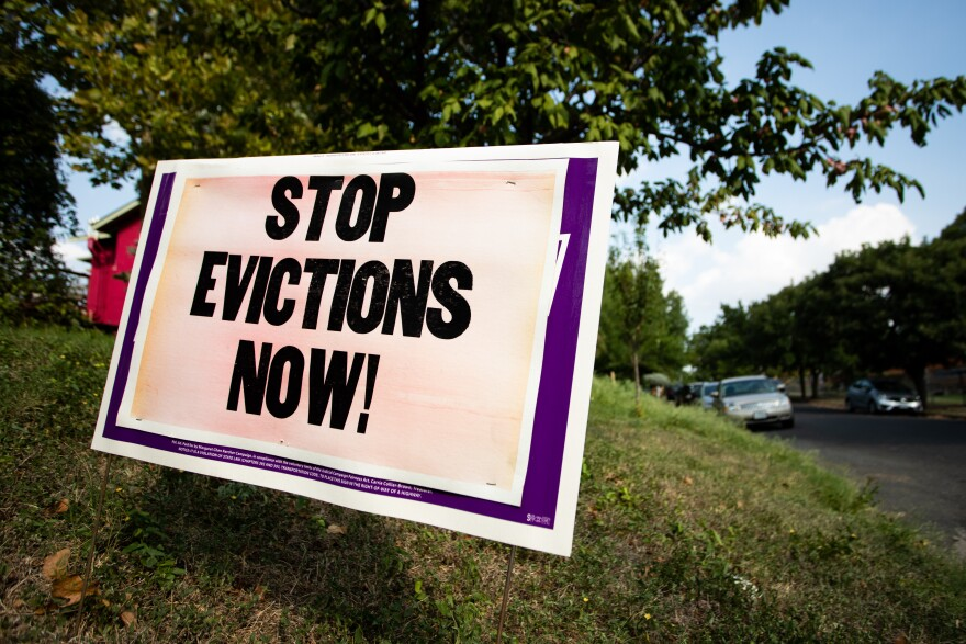 A sign outside a home in Austin's Cherrywood neighborhood calls for an end to evictions during the coronavirus pandemic.