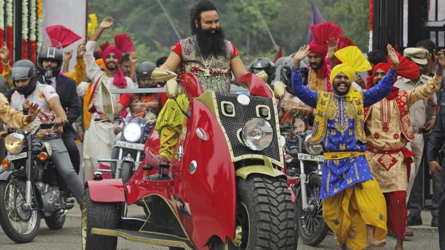 Indian spiritual guru Gurmeet Ram Rahim Singh has been found guilty of raping two female followers. He's seen here last year, arriving for a news conference for his film <em>MSG, The Warrior Lion Heart</em>, in New Delhi.