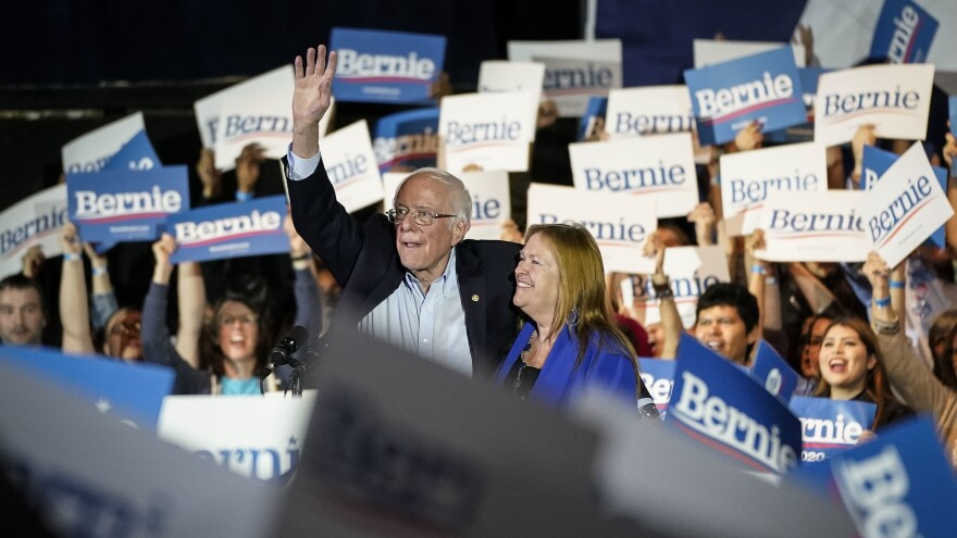 After winning the Nevada Democratic caucuses, Vermont Sen. Bernie Sanders, with his wife, Jane Sanders, waves as they exit the stage at a campaign rally Saturday in San Antonio.