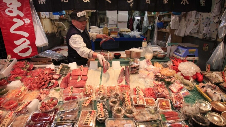 A Tokyo tuna wholesaler adds slices of fish to his stall on March 23. Fish prices have plummeted in Japan amid fears that radioactive material leaking from the damaged Fukushima Dai-ichi nuclear power plant may have contaminated the animals. But experts say there's no risk right now and that fish is safe to eat.