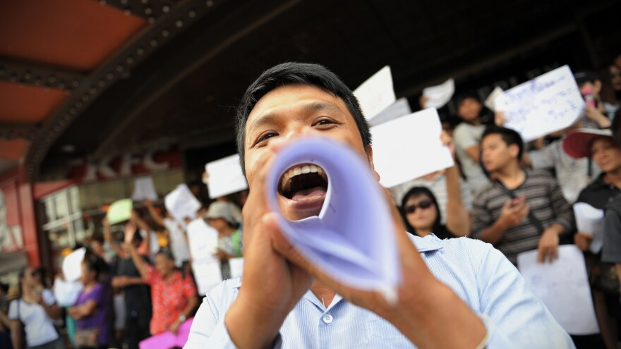 Protesters shout slogans during an anti-coup rally on Saturday in Bangkok, Thailand.