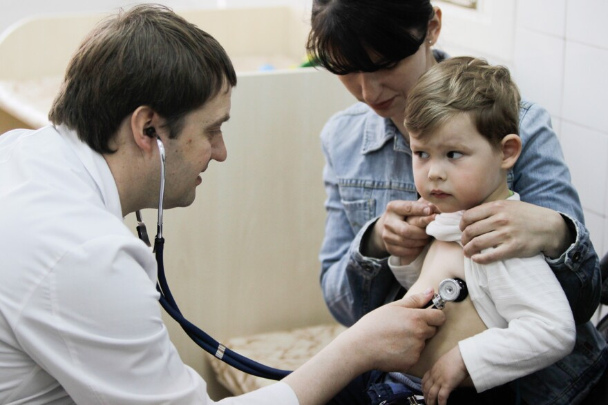 Two polio cases have been reported in Ukraine, where some parents are fearful of vaccinations. Above: A child receives the diphtheria, whooping cough and tetanus vaccine in a children's hospital in Kiev.