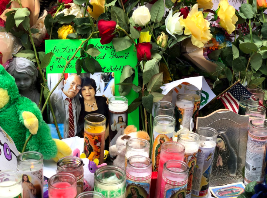 A photo of Adolfo Cerros Hernandez and Sarah Esther Regaldo Moriel, in a memorial near the Walmart