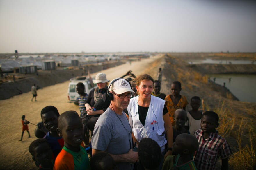 Jason Beaubien talks with Stefania Poggi, who manages the Doctors Without Borders operation. They're standing next to the drainage ponds dug to keep the camp from flooding in rainy season. Kids often jump in for a swim.