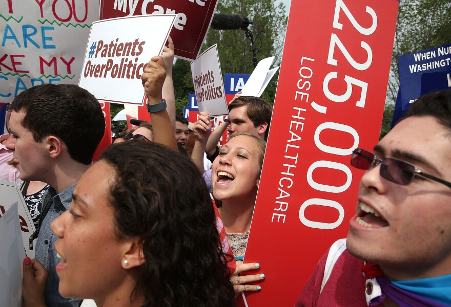 Supporters of the Affordable Care Act cheer outside the Supreme Court in Washington, D.C., after a majority on the court ruled that Obamacare tax credits can continue to go to residents of any state.