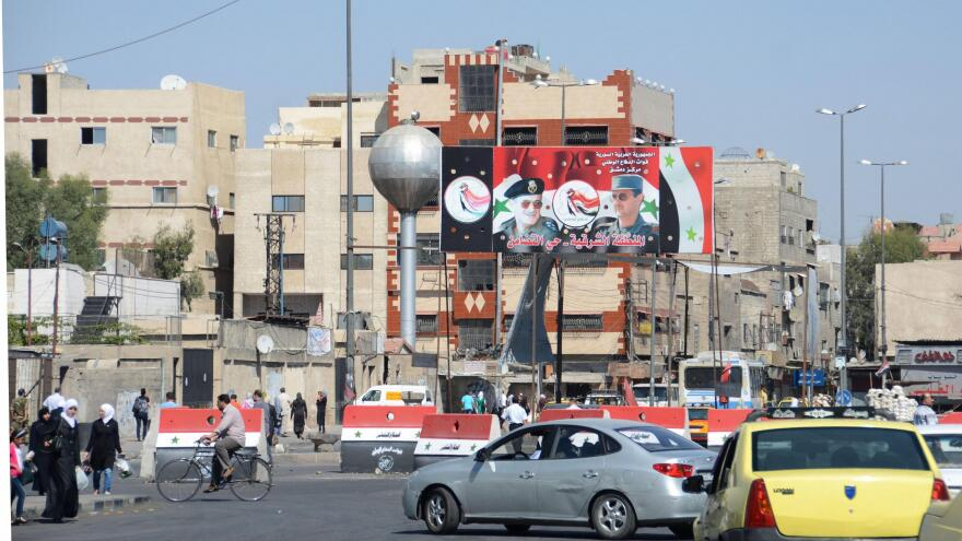 An intersection in Damascus features portraits of Syrian President Bashar Assad and his father, Hafez Assad, who ruled for 30 years before his death in 2000.