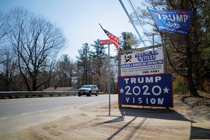 A sign supporting U.S. President Donald Trump stands on the roadside in Troy, N.H last year.