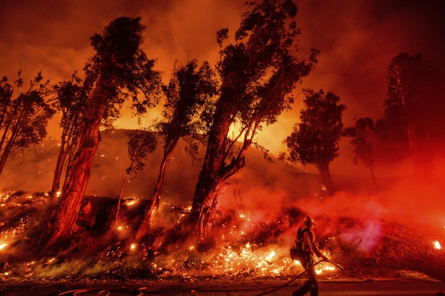 Flames from a backfire consume a hillside as firefighters battle the Maria Fire in Santa Paula, California, on Friday, Nov. 1.