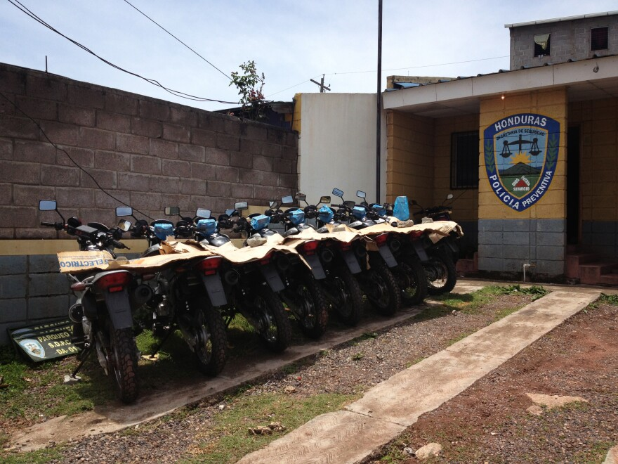 Motorcycles donated by the U.S. State Department sit in the yard at a police precinct in one of Tegucigalpa's roughest neighborhoods.
