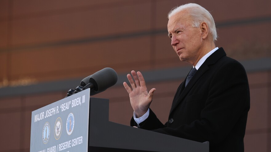 "One day before being inaugurated as the 46th president of the United States, President-elect Joe Biden delivers remarks Tuesday at the Maj. Joseph R. ""Beau"" Biden III National Guard/Reserve Center in New Castle, Del."