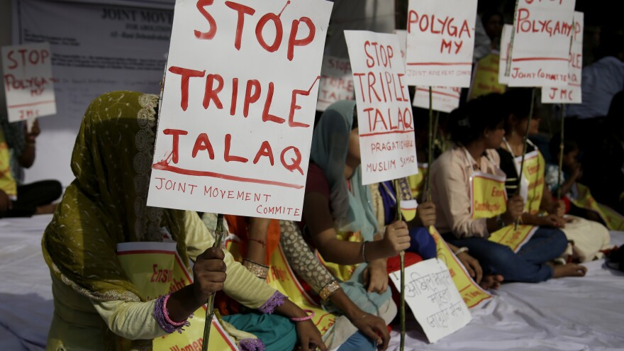 """Activists hold signs during a protest against """"triple talaq,"""" the practice of instant divorce by Muslim men, in New Delhi on May 10. The country's Supreme Court has outlawed this means of ending a marriage."""