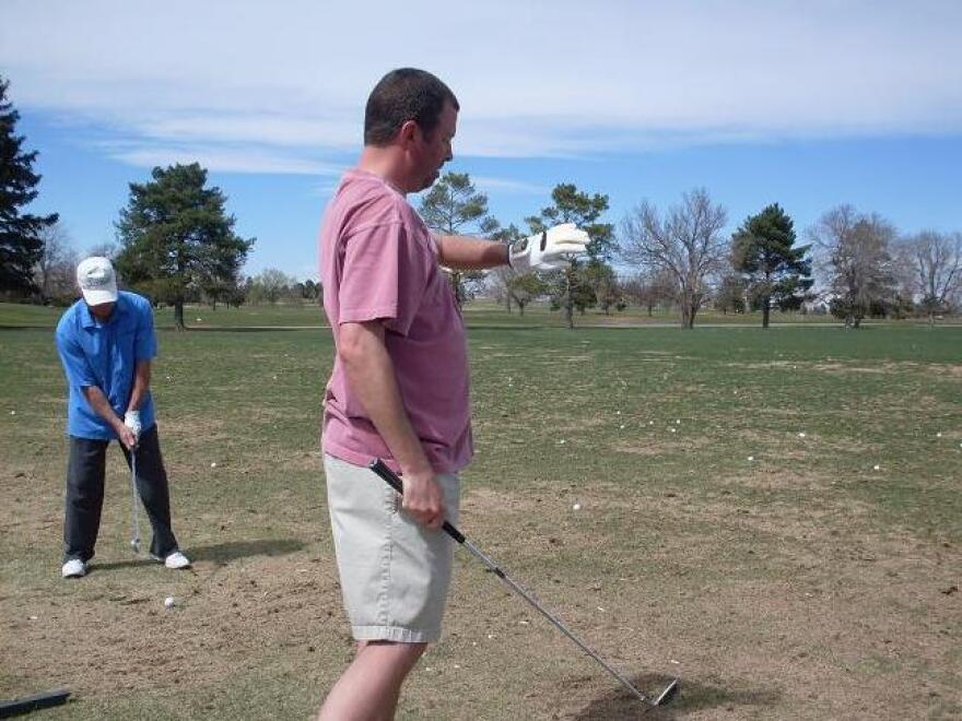 Seasoned golfer Joe Frey tests out the SensoGlove in Denver.