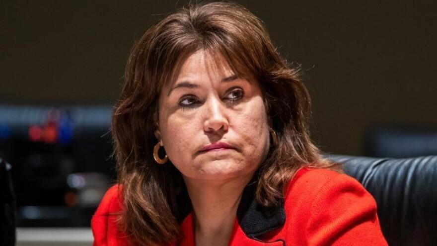 Annette Taddeo listening during a meeting