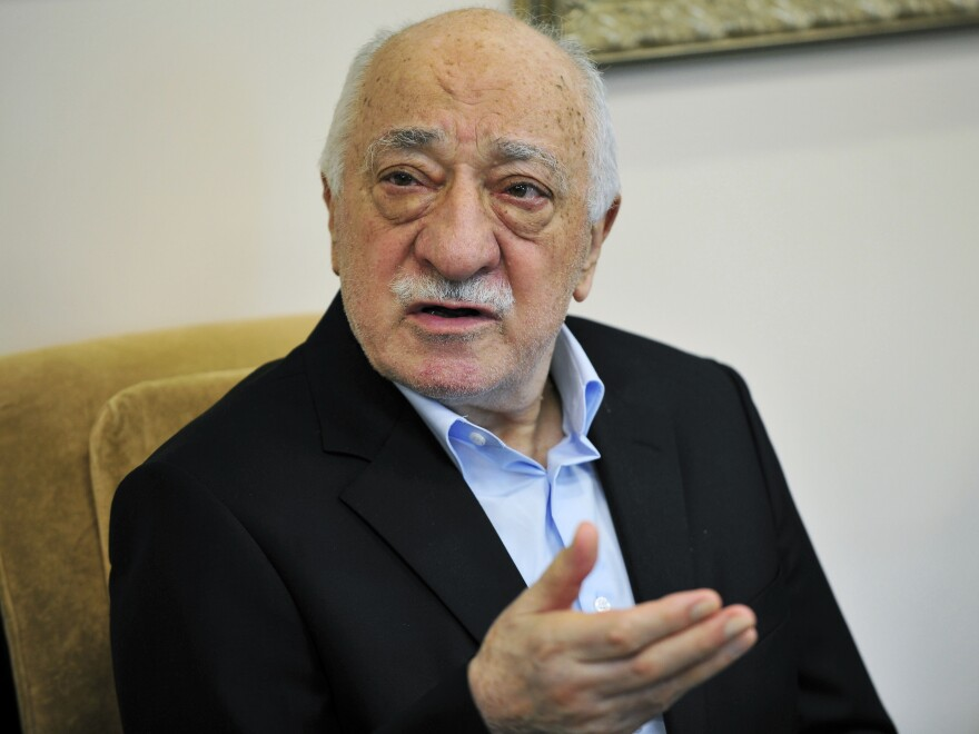 Fethullah Gulen speaks to members of the media last year in Saylorsburg, Pa. The Turkish government accuses Gulen of orchestrating the attempted coup last July, and the recent arrests were directed at purging Gulen's alleged supporters from the ranks of the police force.