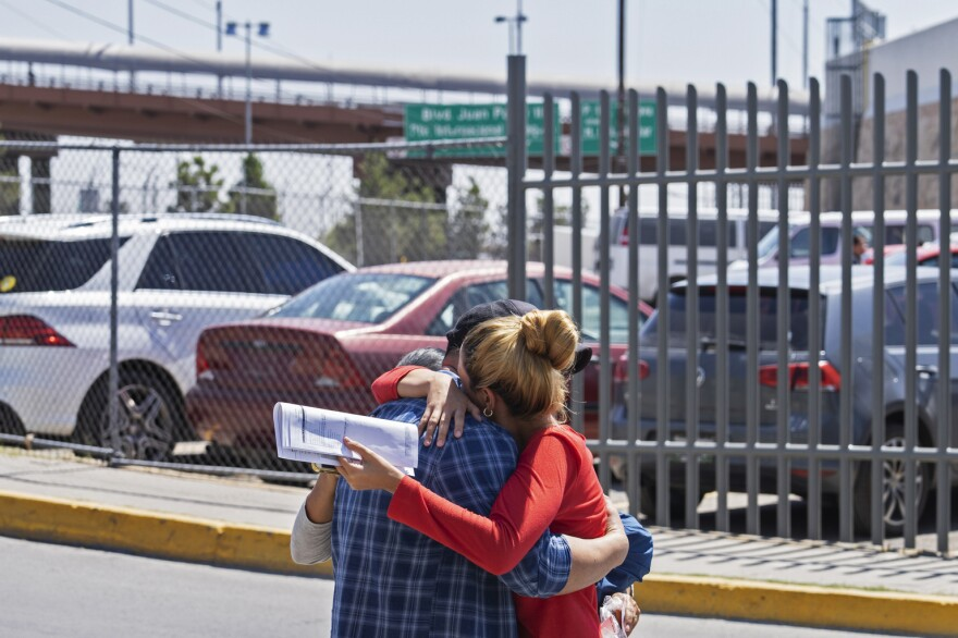 Cuban migrants give each other a tearful hug after being returned to Ciudad Juárez under the Remain in Mexico program.