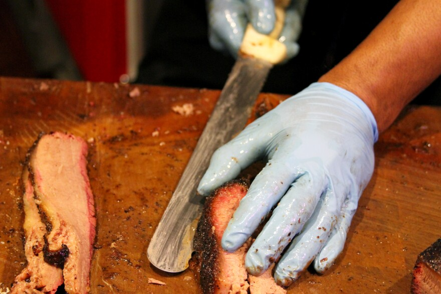 Slicing brisket at Franklin Barbecue in Austin, Texas. The new-found interest in all-wood barbecuing has a lot to do with the success of Aaron Franklin, owner of Franklin Barbecue.