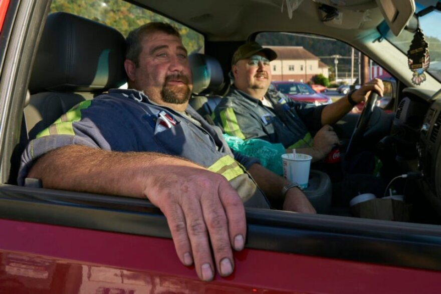 Brothers Mikey and Todd Fuson stop at a grocery store in Pineville after a shift at the coal mine. The mine is currently closed but they feel lucky to still have security and maintenance jobs.