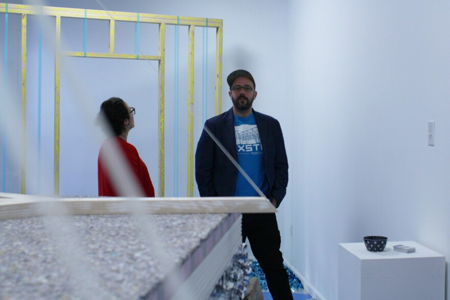 Museum Blue Founders Lauren Cardenas and Michael Behle stand in the exhibit 'Water, Water'