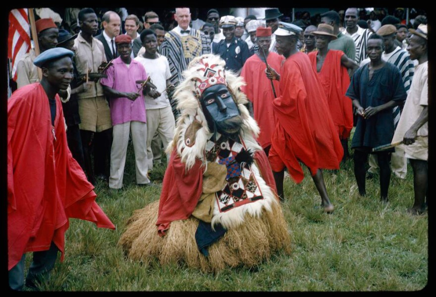 In an image from 1964, a country devil and his attendants prepare for a procession in Lofa County, Liberia.
