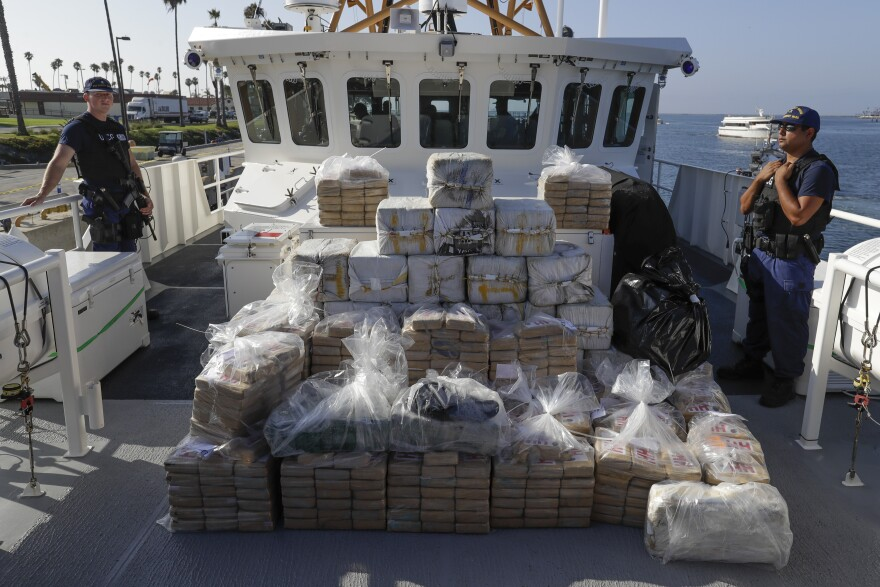 Members of the Coast Guard stand near seized cocaine Thursday, Aug. 29, 2019, in Los Angeles.