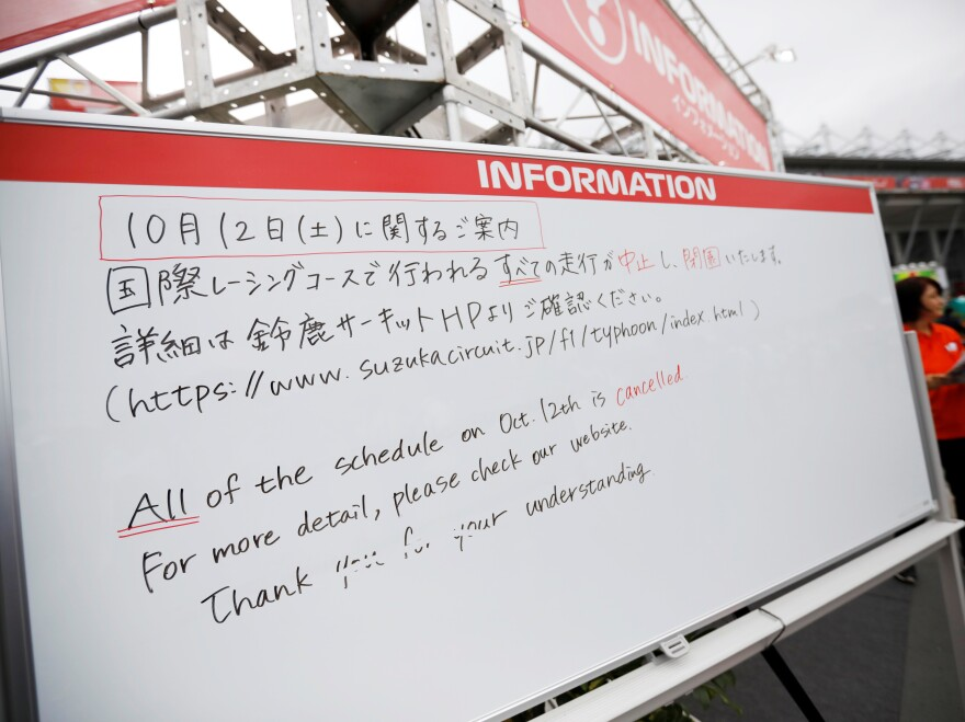 An information board announces the cancellation of all practice and qualifying sessions scheduled for Saturday for the Formula One Japanese Grand Prix because of the approach of Typhoon Hagibis, at Suzuka Circuit in central Japan, on Friday.