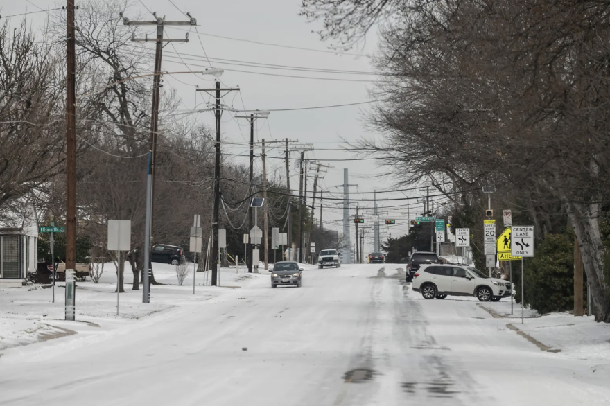 A snow covered Matilda Street in Dallas after a winter storm hit the area on Monday.
