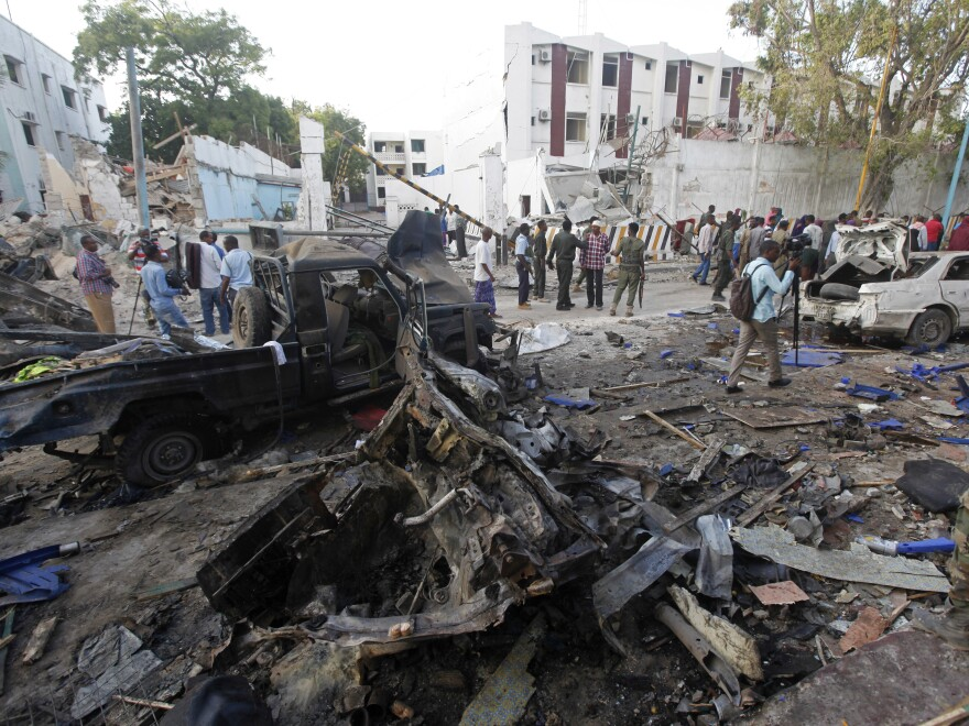 Rescue workers survey the devastation on Sunday after a vehicle bomb was detonated outside a hotel the night before.