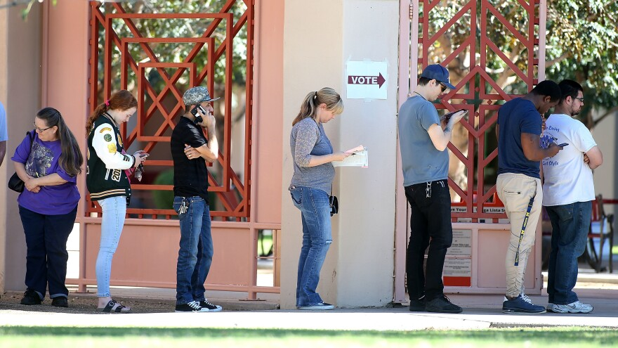 Arizona voters at a Phoenix polling place on Nov. 6, 2018. Arizona is considering major changes to popular early voting rules, which could affect some 200,000 voters.