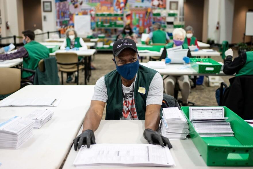Election judges verify and count ballots at the Denver Elections Division building on November 3, 2020 in Denver, Colorado. (CHET STRANGE/AFP via Getty Images)