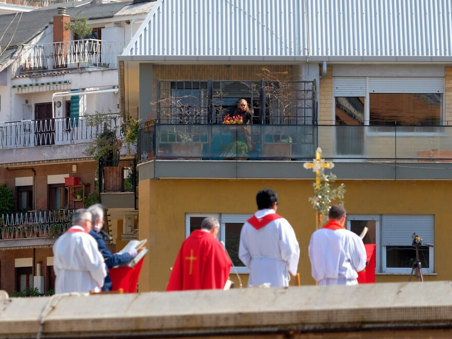 Priests celebrate Palm Sunday Mass on the roof of Saint Pius X Roman Catholic Church in Rome. Churches are closed in Italy due to the coronavirus outbreak.