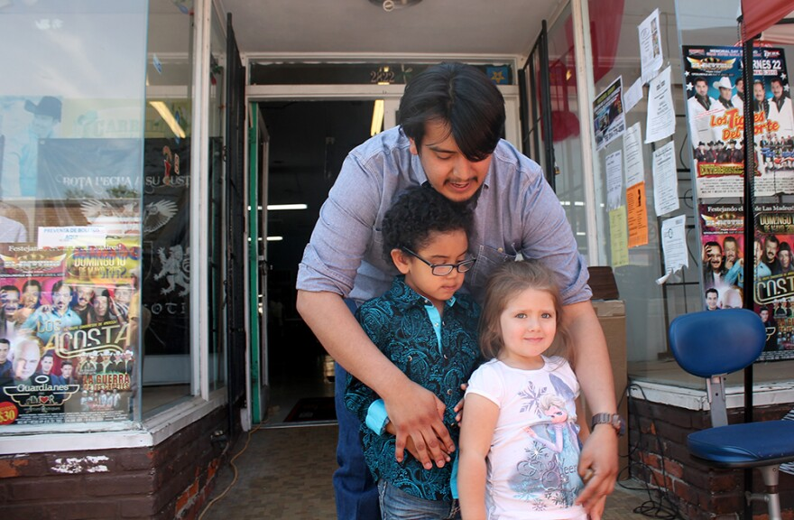Alex Carillo gathers his son Aidan and niece Sophie for a photo outside the family's western wear store on Saturday, May 2, 2015.