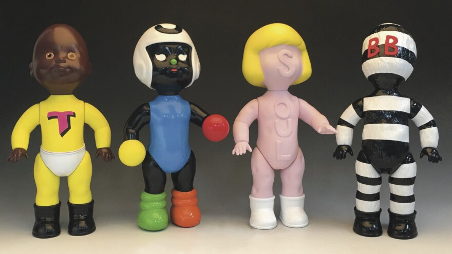 The new exhibition Moundverse Infants at Temple Contemporary in Philadelphia centers around artist Trenton Doyle Hancock's toy dolls. Torpedo Man, the superhero of his artistic cosmology, is portrayed on the left.