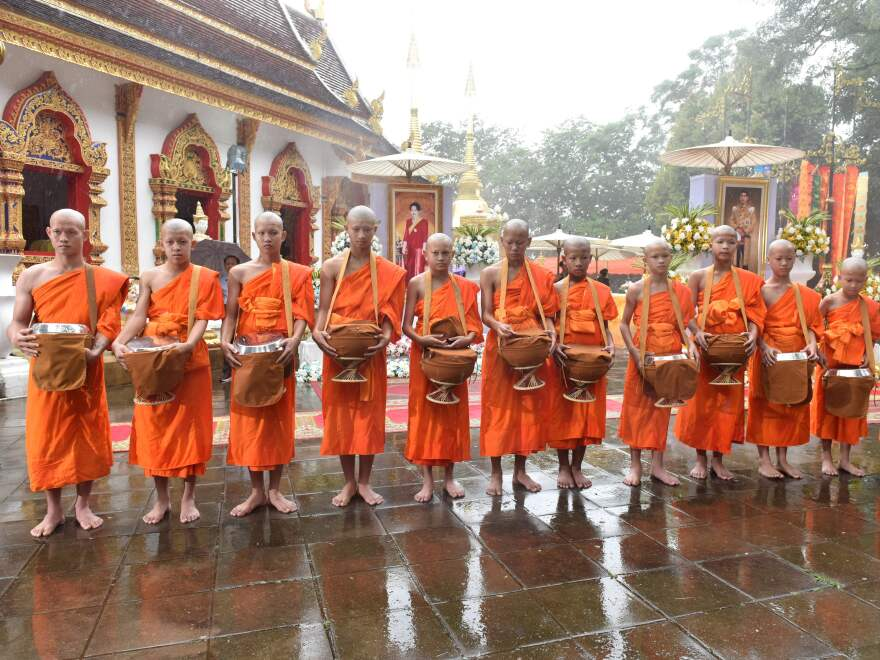 """Rescued Thai boys and members of the """"Wild Boars"""" football team were ordained as novice Buddhist monks in a ceremony Wednesday. Their coach, Ekapol Chanthawong (left), was ordained as a monk."""