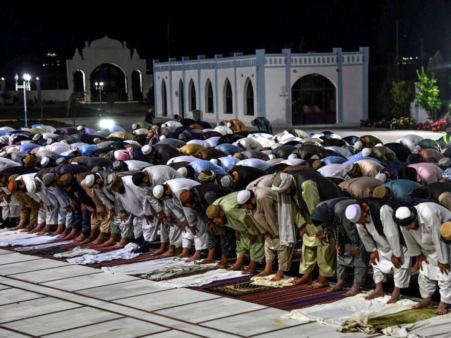 Muslims partake in evening prayers at a mosque in Kandahar, Afghanistan, in April. The Taliban have declared a cease-fire for an upcoming holiday.