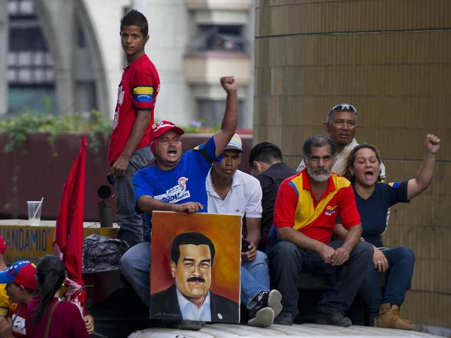 Supporters of Venezuelan President-elect Nicolas Maduro attend a meeting in Caracas on Monday.