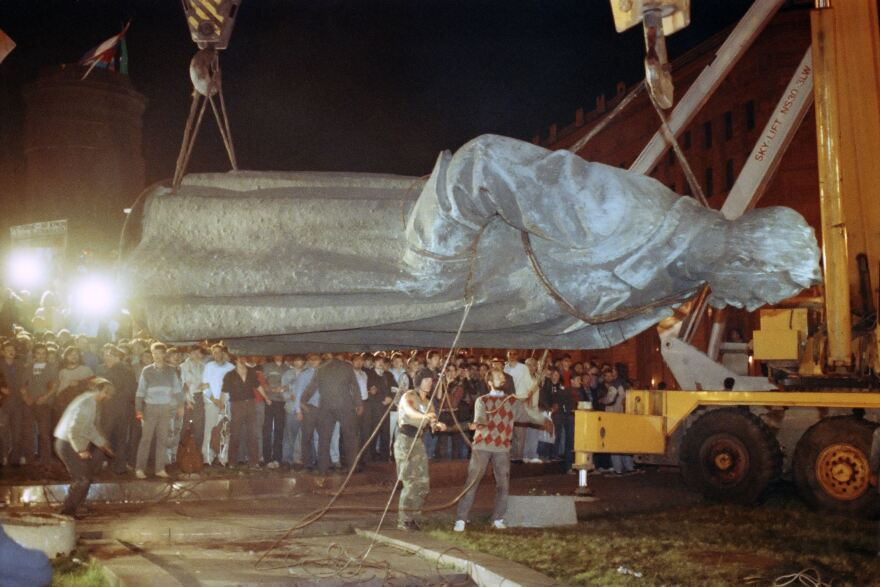 The U.S. isn't the only country where statues of controversial historical figures have been swept aside by protesters seeking a clean break with the past. Above, workers load a statue of KGB founder Felix Dzerzhinsky on a flatbed truck after it was toppled in Moscow on Aug. 23, 1991.
