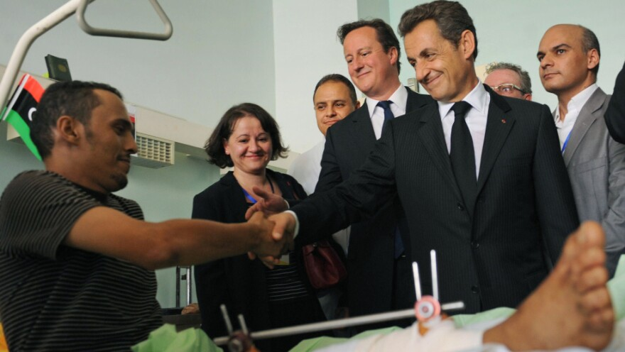 British Prime Minister David Cameron, center, and French President Nicholas Sarkozy, second right, visited with patients at the Tripoli Medical Center today (Sept. 15, 2011).
