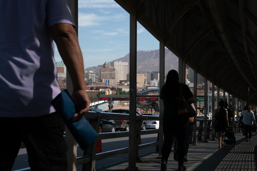 People cross the Paso del Norte International Bridge in the morning on their way to the U.S. Migrants with scheduled court hearings cross the bridge before being taken into custody and transported to court.