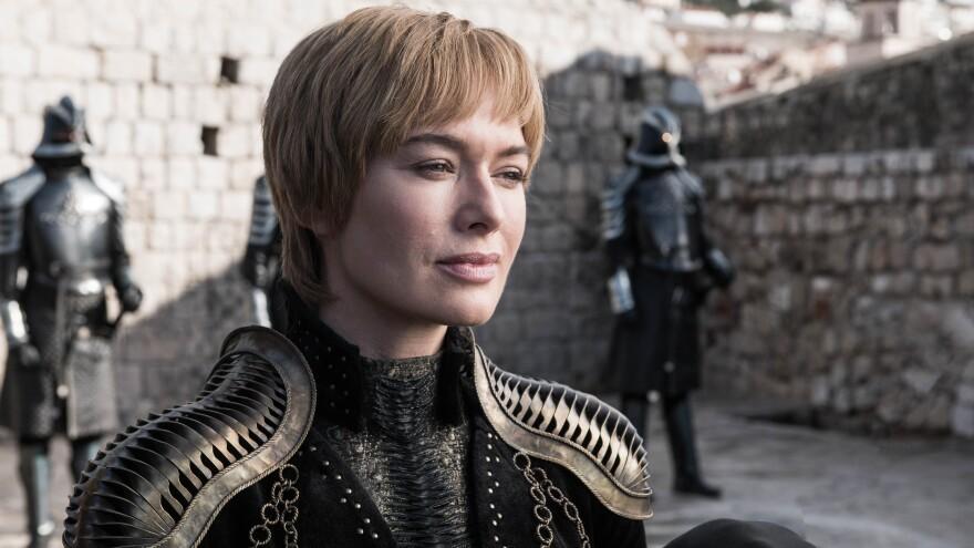 Queen Cersei (Lena Headey) smiling that smile of hers on <em>Game of Thrones.</em> Shoulder pads courtesy of Julia Sugarbaker.
