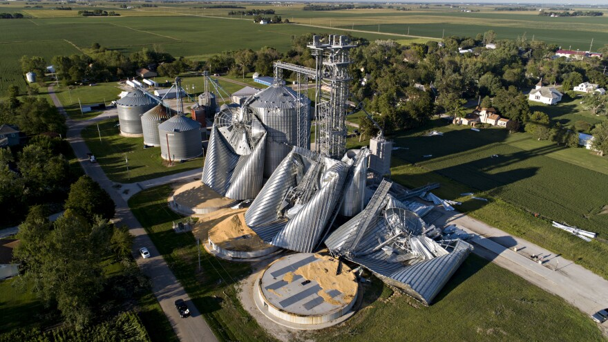 In this aerial image from a drone, damaged grain bins are shown at the Heartland Co-Op grain elevator in Luther, Iowa, on Tuesday.